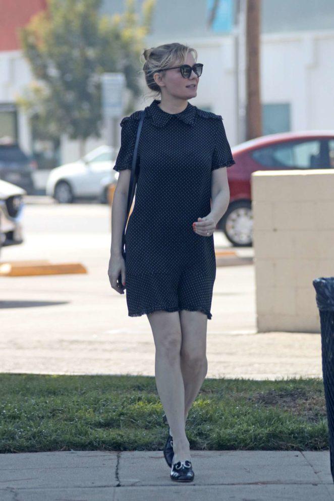 Kirsten Dunst in a black dress as she leaves Joan's on Third in LA