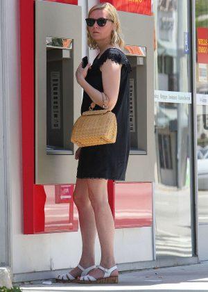 Kirsten Dunst in Short Black Dress out in Los Angeles