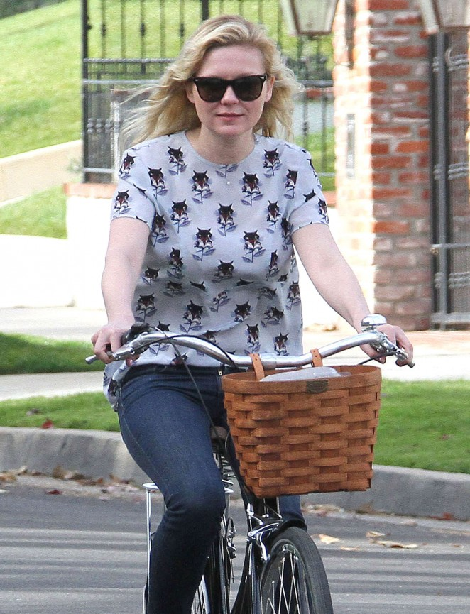 Kirsten Dunst - Riding a Bike Out in LA