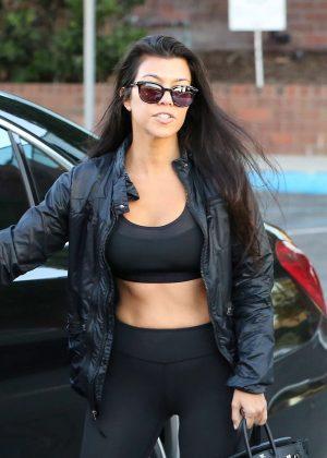 Kourtney Kardashian in a black sports bra and leggings in Calabasas