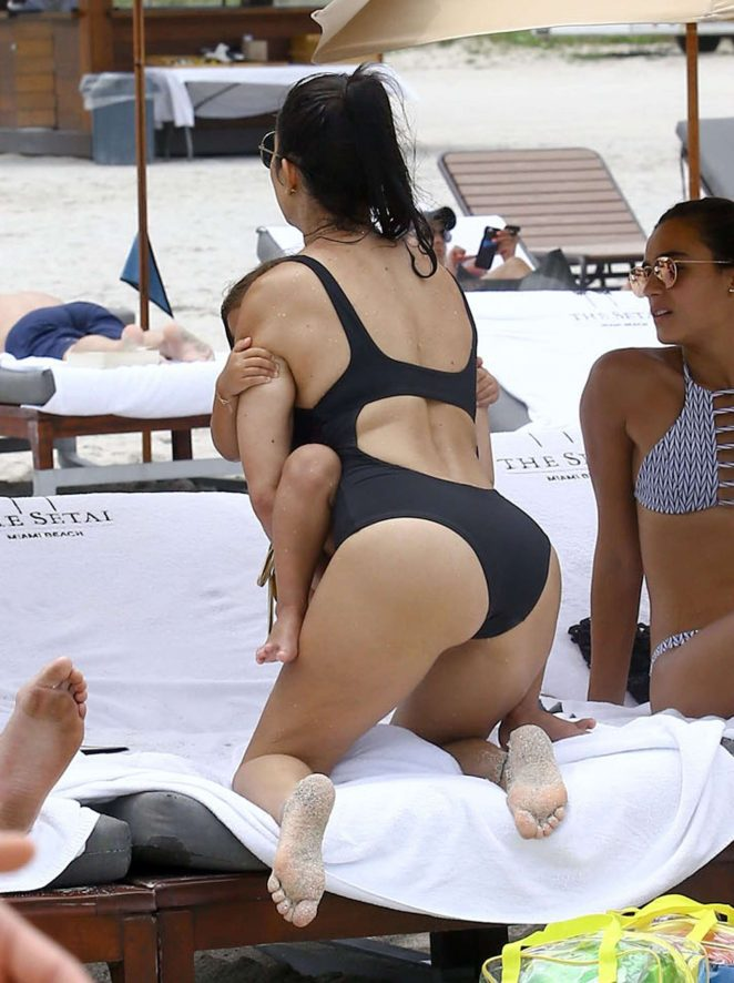 Kourtney Kardashian in Back Swimsuit at a beach in Miami