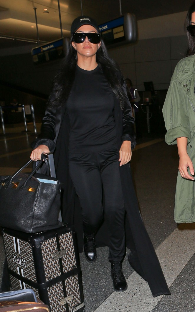 Kourtney Kardashian in Black at LAX Airport in Los Angeles