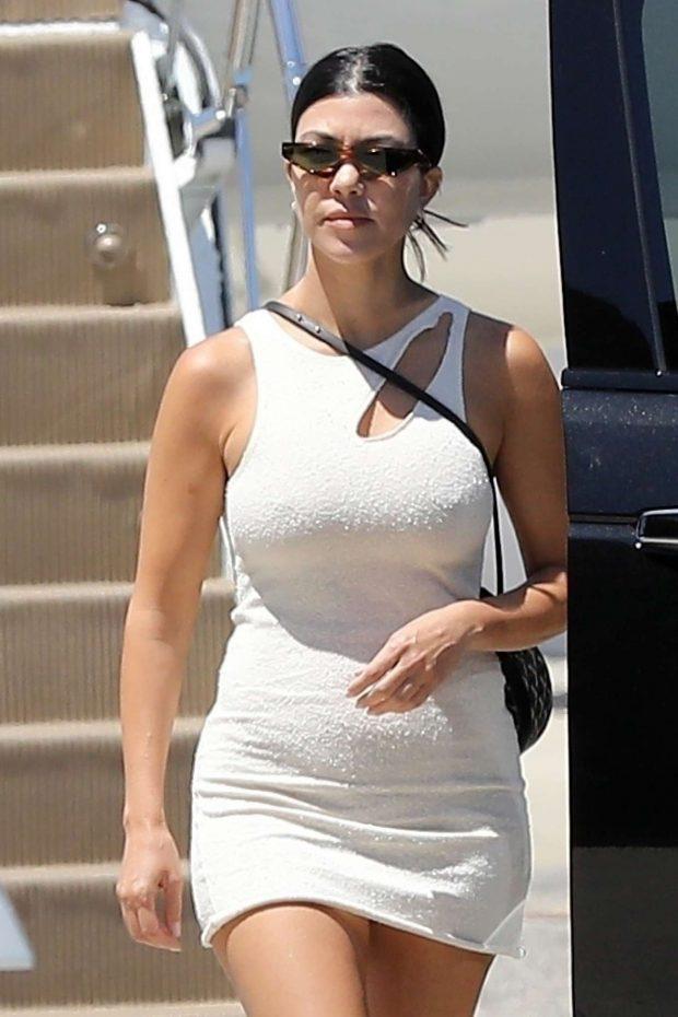 Kourtney Kardashian in Mini Dress - Returns to Los Angeles