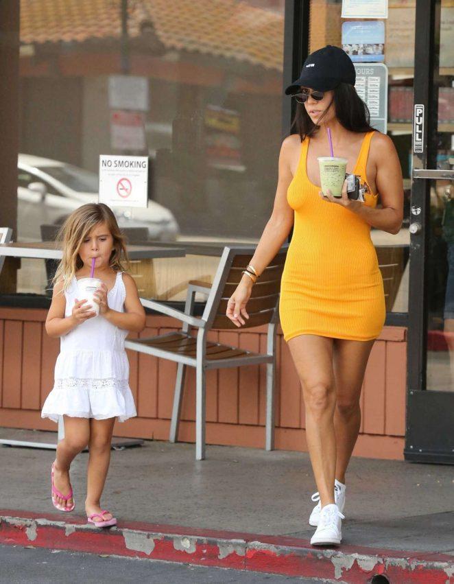 Kourtney Kardashian in Yellow Mini Dress -01