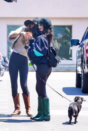 Kourtney Kardashian - Out in green western boots in Malibu