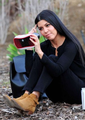 Kourtney Kardashian - Putting together a toy in Los Angeles