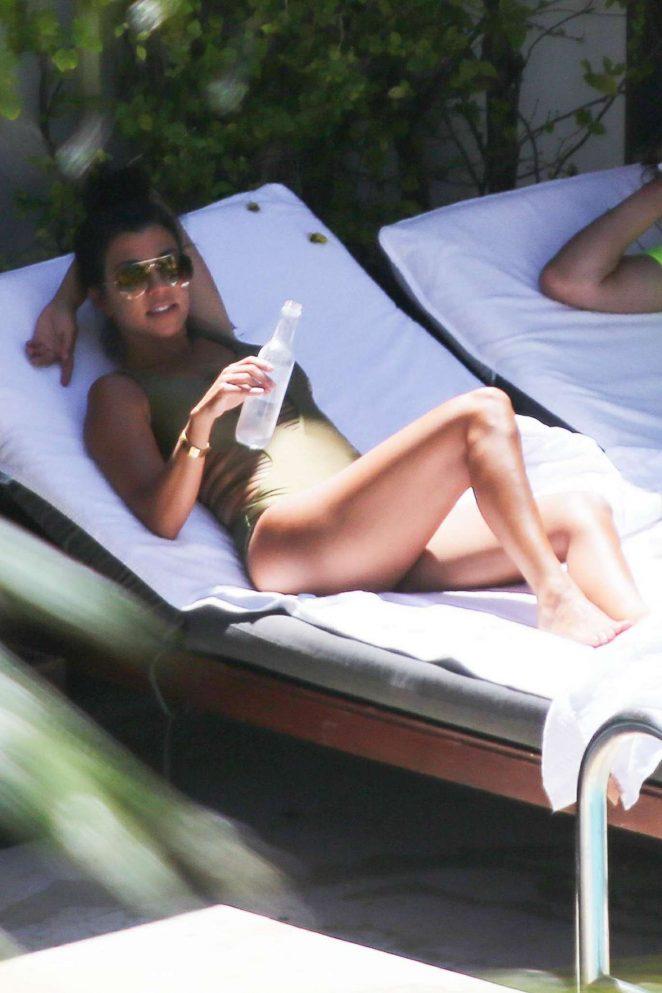 Kourtney Kardashian – Wearing a swimsuit at the pool in Miami