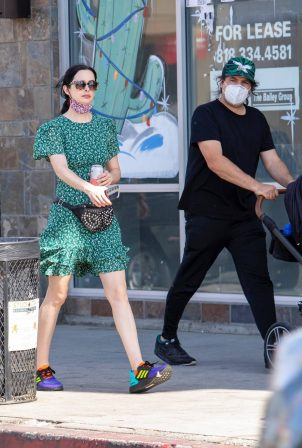 Kristen Ritter - In green dres with her husband Adam Granofsky in Studio City