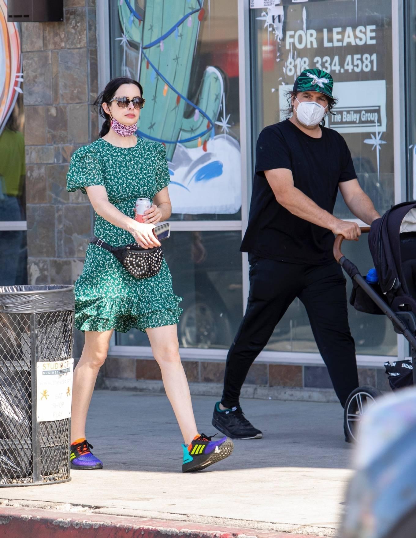 Kristen Ritter - In green dres with her husband Adam Granofsky in Studio City