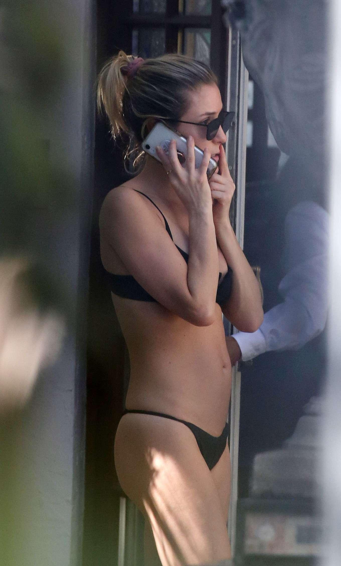 Kristin Cavallari in Black Bikini at a pool in Miami