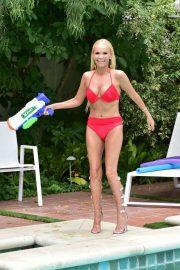 Kristin Chenoweth in Red Bikini on the pool in Beverly Hills