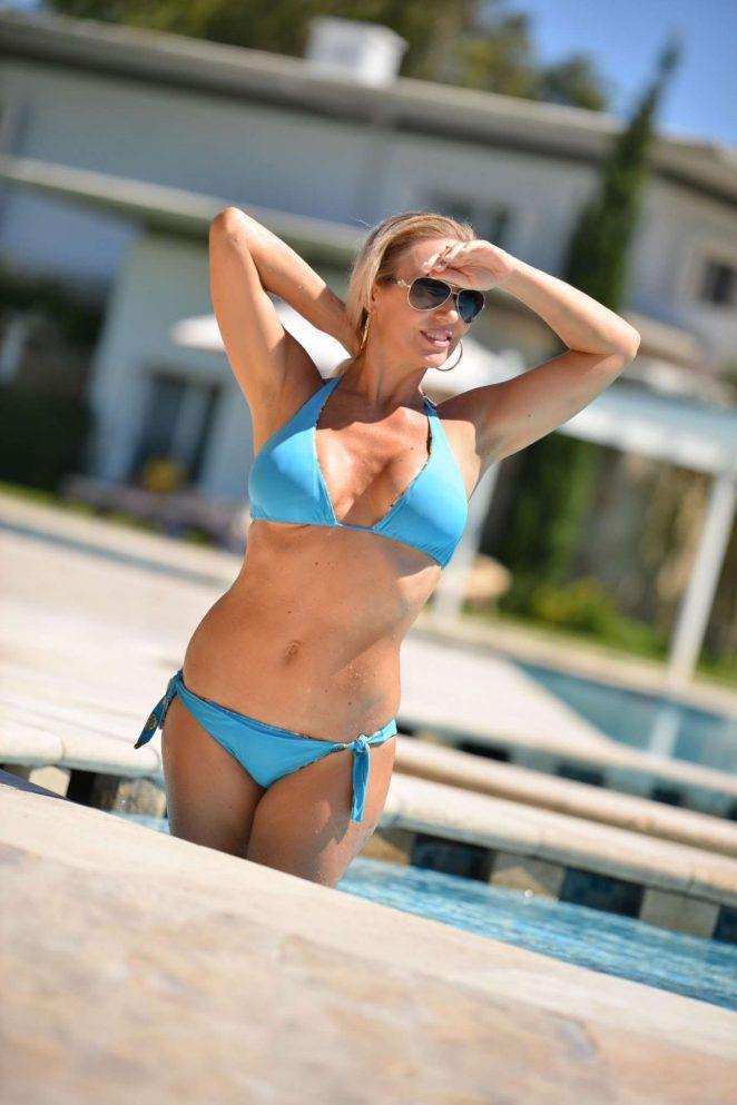 Kristina Rihaboff in Blue Bikini on the pool in Turkey