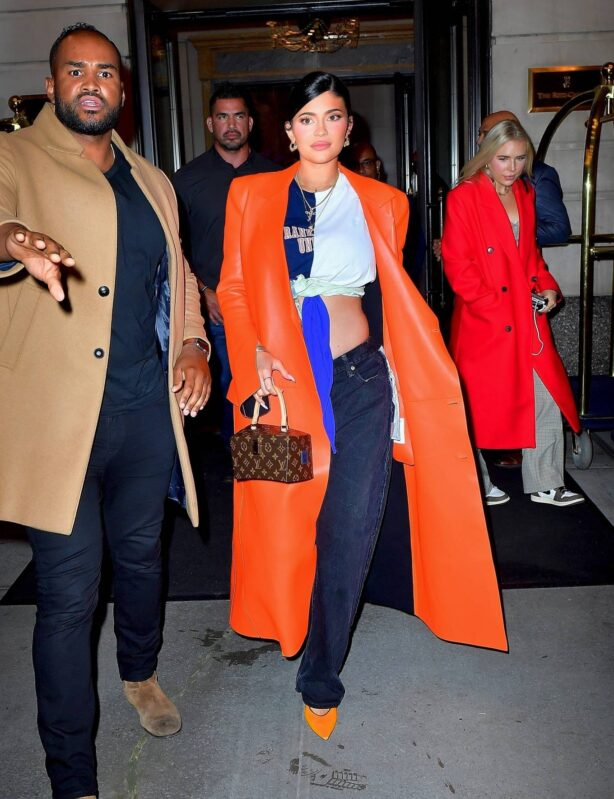 Kylie Jenner - Dons orange coat on the way to dinner in New York