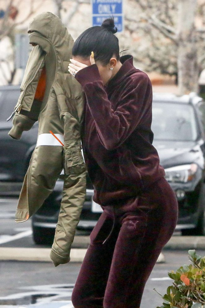 Kylie Jenner - Hides her face at Bui Sushi in Malibu