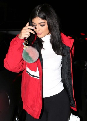 Kylie Jenner in a red coat for dinner in Beverly Hills