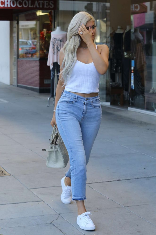 763345d264ac7 Kylie Jenner in a white tank top and jeans -05 – GotCeleb