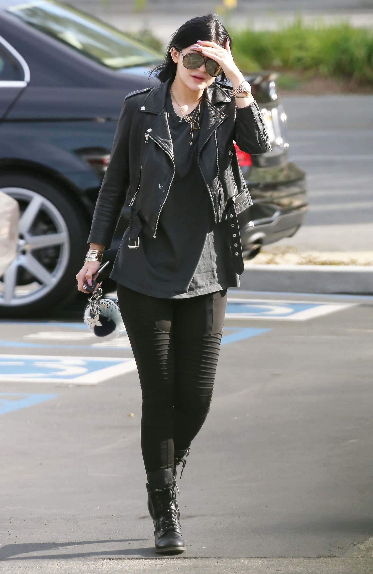 Leather jacket olx - Kylie Jenner In Tights And Leather Jacket 16 Gotceleb