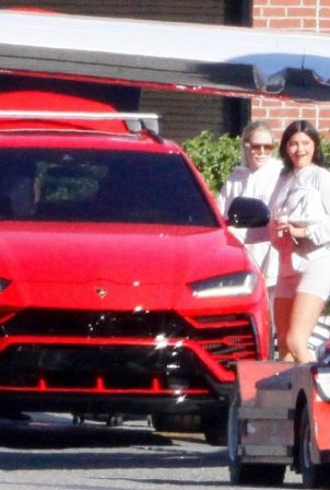 Kylie Jenner - pulls up to her private jet in a red Lamborghini in Los Angeles