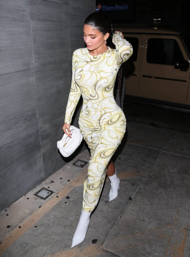 Kylie Jenner - Wearing a tight dress with white boots at Nobu in West Hollywood