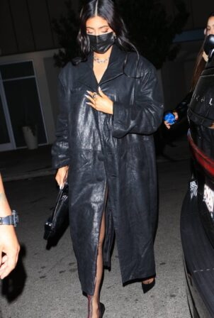 Kylie Jenner - Wearing black trench coat while at The Nice Guy in West Hollywood