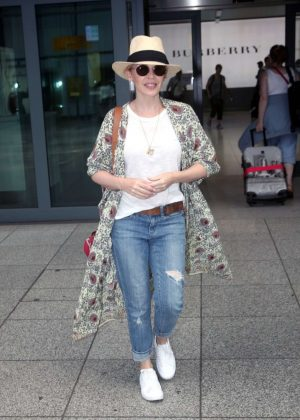 Kylie Minogue - Arrives at Heathrow airport in London