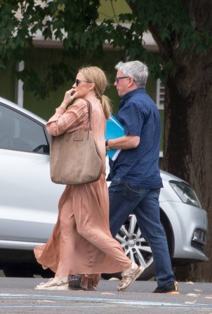 Kylie Minogue - In a flowing peach coloured dress while out with her father Ron Minogue in Vivtoria