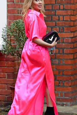 Kylie Minogue - In an electric pink silk outfit in South London