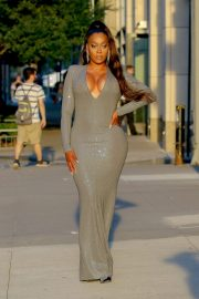 La La Anthony - Spotted in long dress while leaving her apartment in New York City