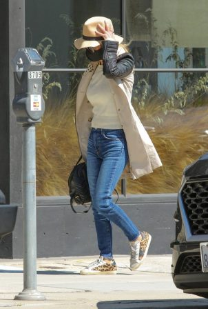 Laeticia Hallyday - In a long coat carrying a Gucci backpack purse in Beverly Hills
