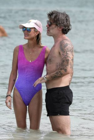Laeticia Hallyday - In a swimwear on a holiday at the beach in St Barths