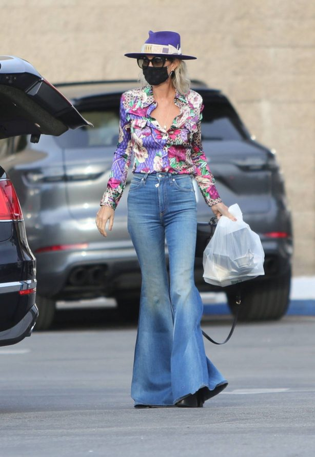Laeticia Hallyday - In her flared denim at store Mitsuwa in Los Angeles