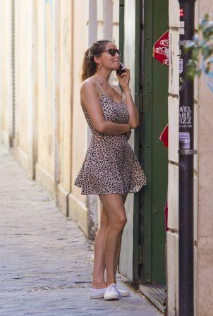 Laetitia Casta with doughter Sahteene Sednaoui - Shopping candids in Rome