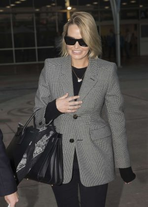 Lara Bingle Worthington Arrives at Sydney Airport