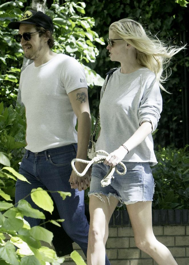 Lara Stone with her boyfriend out in London