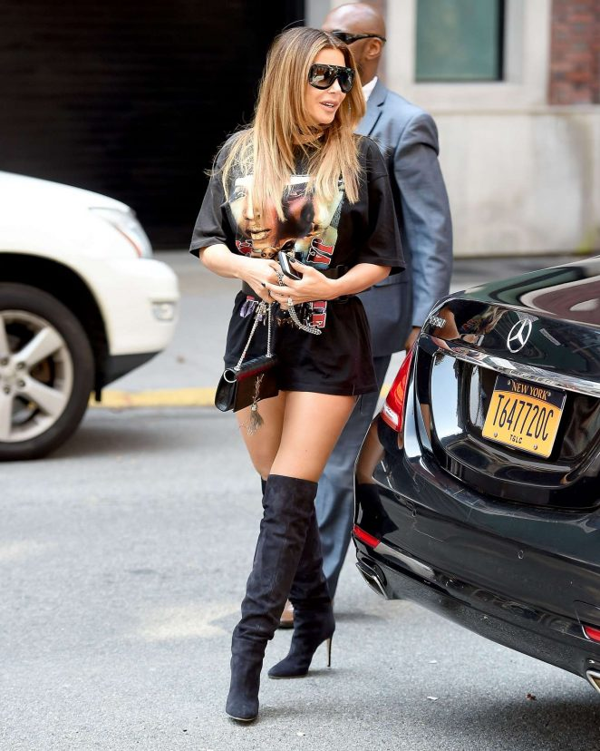 Larsa Pippen in a black tee shirt and black boots in New York City