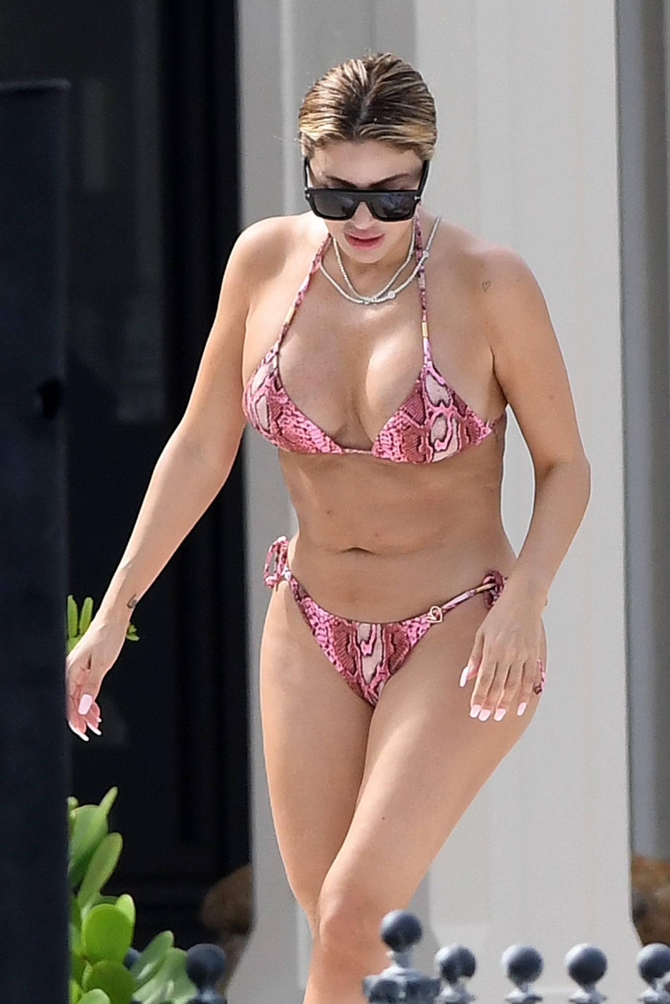 Larsa Pippen - In a pink snakeskin bikini in Ft. Lauderdale