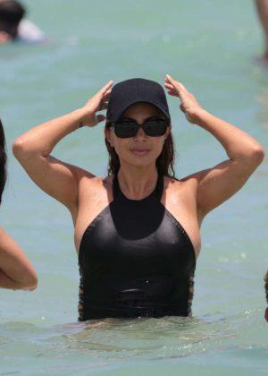 Larsa Pippen in Black Swimsuit on the beach in Miami