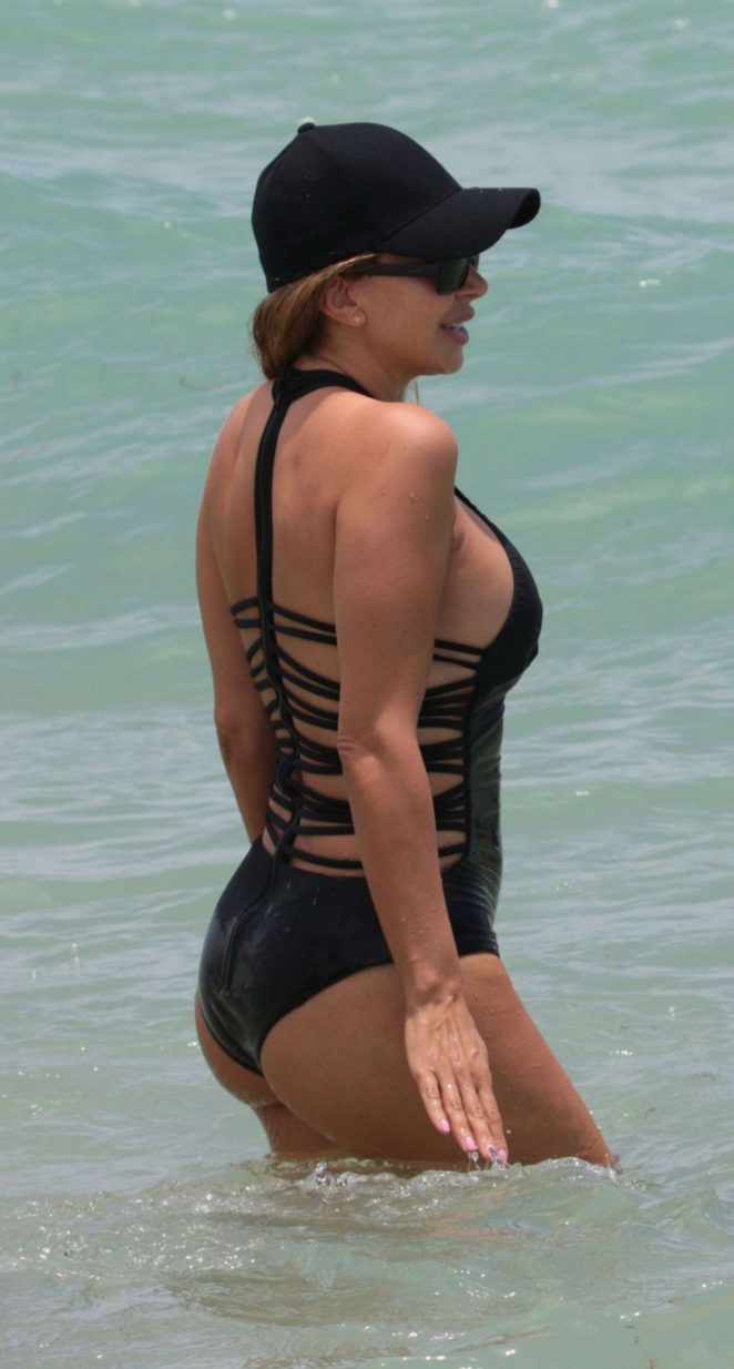Larsa Pippen in Black Swimsuit on the beach in Miami