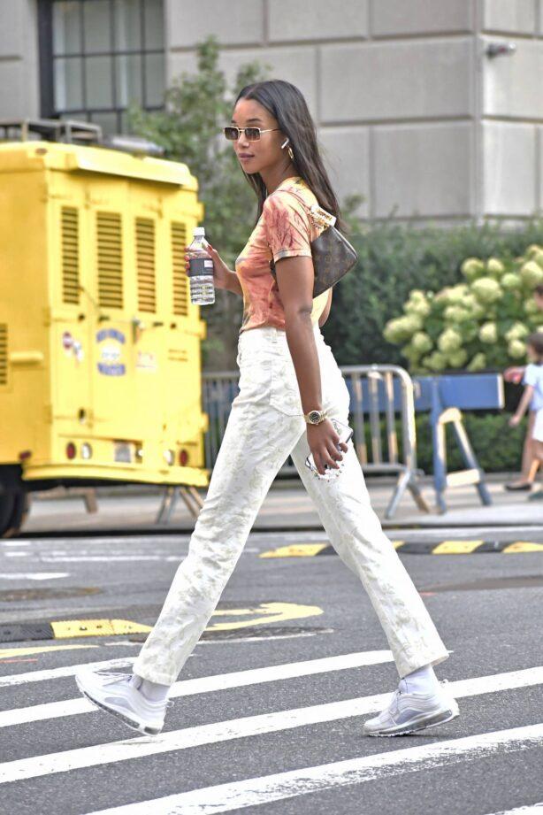 Laura Harrier - Wears a tie-die shirt along Fifth Avenue in New York