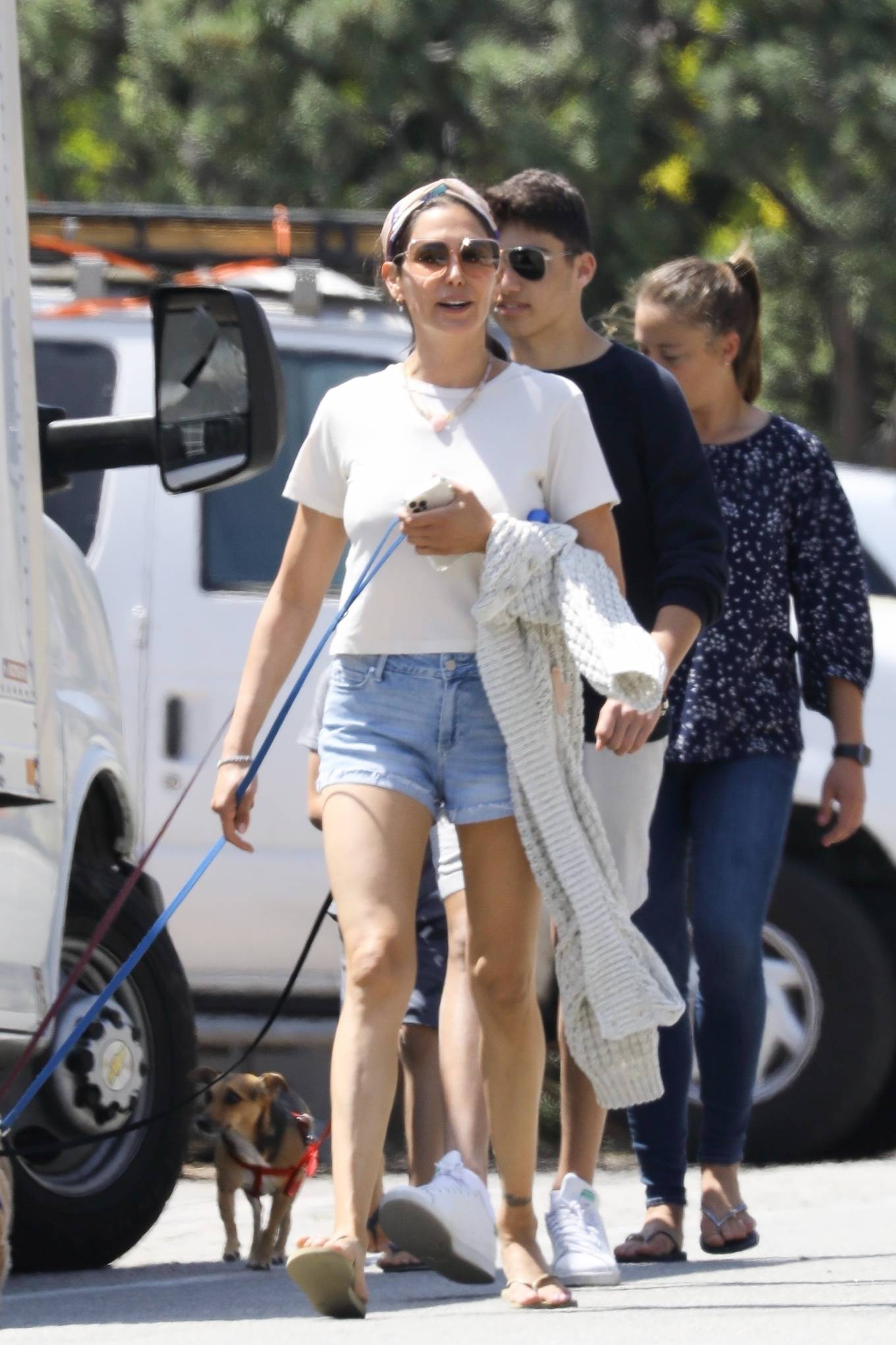 Laura Silverman - Out for a stroll with her family and their dogs in Malibu