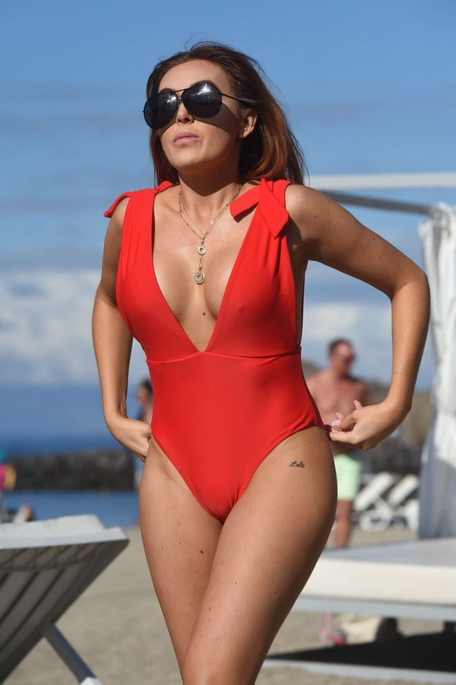 Laura Simpson in Red Swimsuit on the beach in the Canary Islands