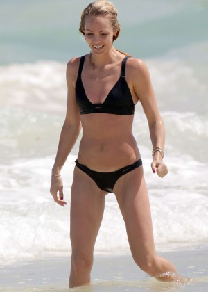 Laura Vandervoort in Black Bikini at a beach in Mexico