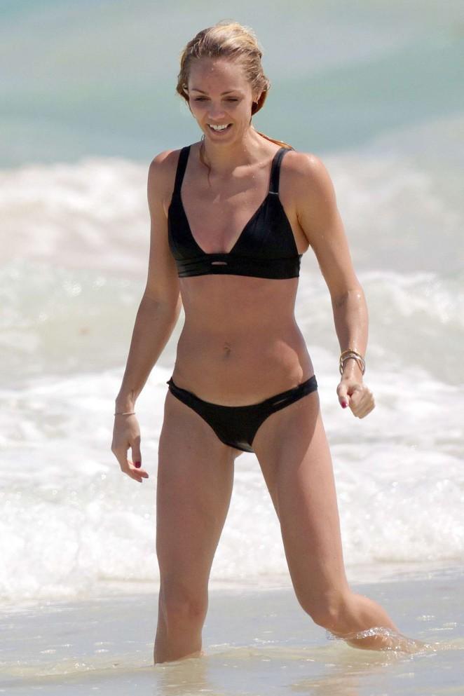 Laura Vandervoort in Black Bikini at a beach in Mexico