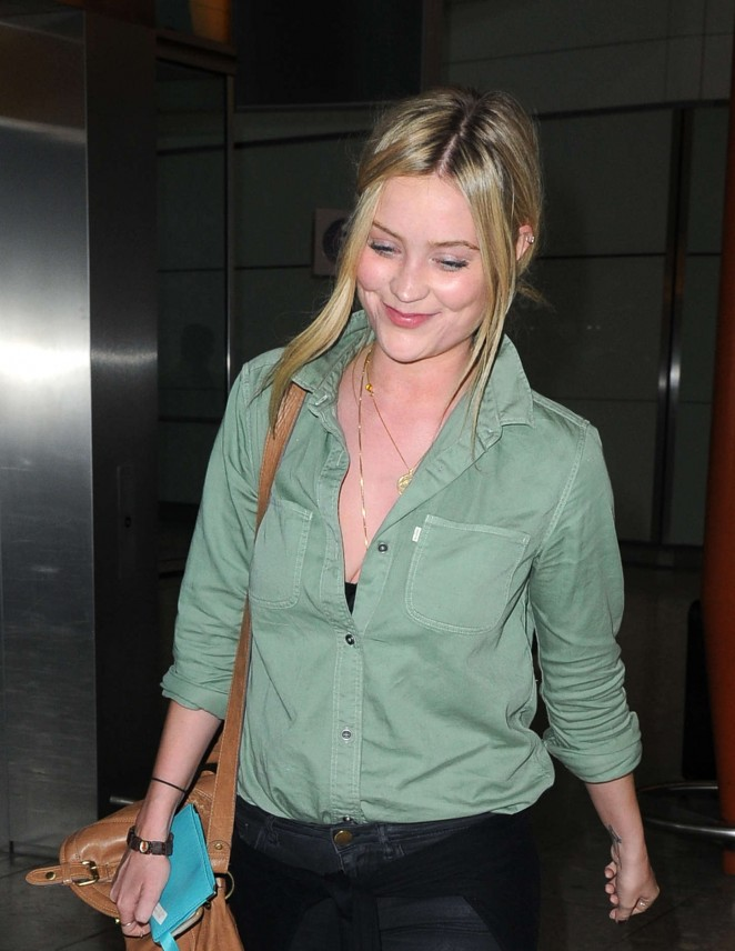 Laura Whitmore at Heathrow Airport in London