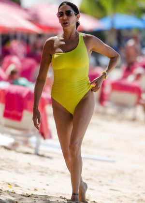 Lauren Silverma in Yellow Swimsuit on the beach in Barbados