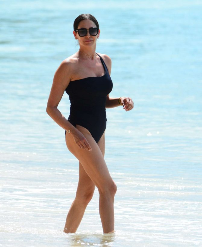 Lauren Silverman in Black Swimsuit at the beach in Barbados