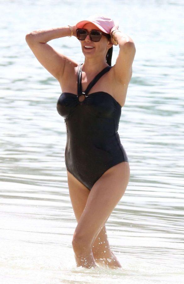 Lauren Silverman in Black Swimsuit on the beach in Barbados
