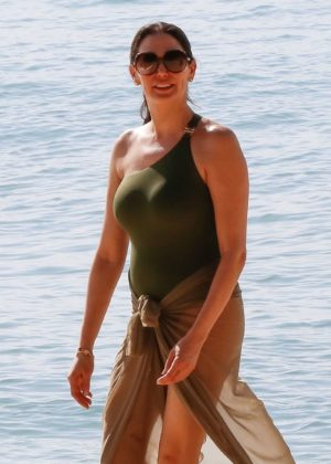 Lauren Silverman in Green Swimsuit at a beach in Barbados