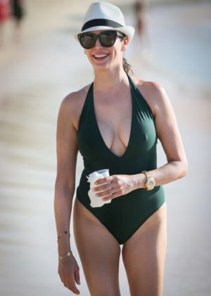 Lauren Silverman in Green Swimsuit at the beach in Barbados