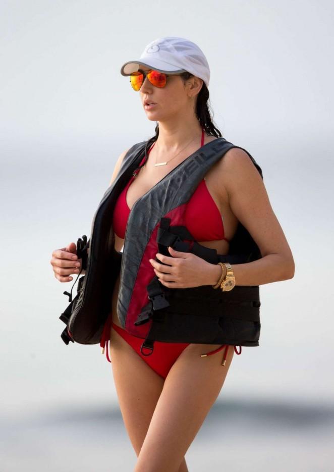 Lauren Silverman in Red Bikini on Jet-skiing in Barbados